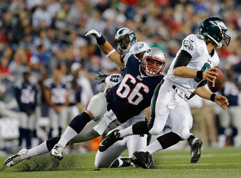 FOXBORO, MA - AUGUST 20:   Jake Bequette #66 of the New England Patriots attempts  during bring down  Nick Foles #9 of the Philadelphia Eagles during a preseason game at Gillette Stadium on August  20, 2012 in Foxboro, Massachusetts. (Photo by Jim Rogash/
