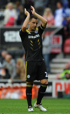 WIGAN, ENGLAND - AUGUST 19:  John Terry of Chelsea applauds the supporters following the Barclays Premier League match between Wigan Athletic and Chelsea at DW Stadium on August 19, 2012 in Wigan, England.  (Photo by Chris Brunskill/Getty Images)