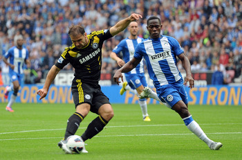 WIGAN, ENGLAND - AUGUST 19:  Branislav Ivanovic of Chelsea scores the opening goal during the Barclays Premier League match between Wigan Athletic and Chelsea at DW Stadium on August 19, 2012 in Wigan, England.  (Photo by Chris Brunskill/Getty Images)