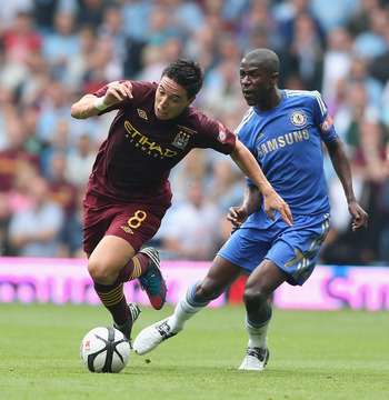 BIRMINGHAM, ENGLAND - AUGUST 12:  Samir Nasri of  Manchester City is brought down by Ramires during the FA Community Shield match between Manchester City and Chelsea at Villa Park on August 12, 2012 in Birmingham, England.  (Photo by David Rogers/Getty Im