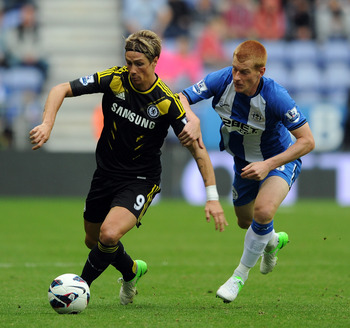 WIGAN, ENGLAND - AUGUST 19:  Fernando Torres of Chelsea in action with Ben Watson of Wigan Athletic during the Barclays Premier League match between Wigan Athletic and Chelsea at DW Stadium on August 19, 2012 in Wigan, England.  (Photo by Chris Brunskill/