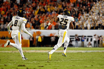 Darwin Cook (25) races to the end zone in the Orange Bowl