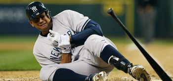 New York Yankees 3B Alex Rodriguez falls to the ground after getting hit by a pitch.