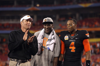 We will see how Gundy (left) does coaching an offense without Blackmon (center)