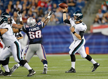 FOXBORO, MA - AUGUST 20:   Nick Foles #9 of the Philadelphia Eagles throws by the defense of  Justin Francis #68 of the New England Patriots during a preseason game at Gillette Stadium on August  20, 2012 in Foxboro, Massachusetts. (Photo by Jim Rogash/Ge