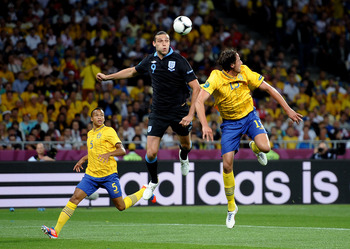 Andy Carroll gearing up for a header against Sweden