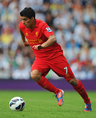 Luis Suarez dribbling the ball