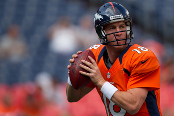 DENVER, CO - AUGUST 18:  Quarterback Peyton Manning #18 of the Denver Broncos warms up before a game against the Seattle Seahawks at Sports Authority Field Field at Mile High on August 18, 2012 in Denver, Colorado. (Photo by Justin Edmonds/Getty Images)