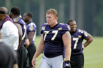 Matt Birk (77) is impressed with the young O-linemen