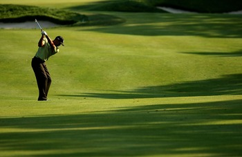 NORTON, MA - AUGUST 31: Tiger Woods hits his approach shot on the 14th hole during the first round of the Deutsche Bank Championship, the second event of the new PGA TOUR Playoffs for the FedexCup at TPC Boston on August 31, 2007 in Norton, Massachusetts.