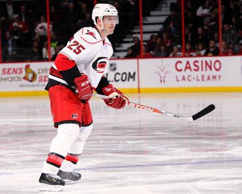 OTTAWA, ON - NOVEMBER 27:  Joni Pitkanen #25 of the Carolina Hurricanes skates in a game against the Ottawa Senators at Scotiabank Place on November 27, 2011 in Ottawa, Canada.  (Photo by Phillip MacCallum/Getty Images)