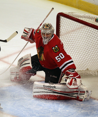 CHICAGO, IL - APRIL 23:  Corey Crawford #50 of the Chicago Blackhawks moves to the puck against the Phoenix Coyotes in Game Six of the Western Conference Quarterfinals during the 2012 NHL Stanley Cup Playoffs at the United Center on April 23, 2012 in Chic