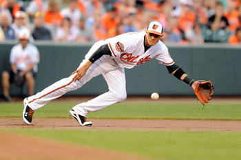 BALTIMORE, MD - AUGUST 09:  Manny Machado #13 of the Baltimore Orioles dives for and misses a ball in the first inning of his major league debut against the Kansas City Royals at Oriole Park at Camden Yards on August 9, 2012 in Baltimore, Maryland.  (Phot