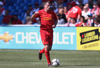 TORONTO, CANADA - JULY 21: Jamie Carragher #23 of Liverpool dribbles the ball against Toronto FC during the World Football Challenge friendly match on July 21, 2012 at Rogers Centre in Toronto, Ontario, Canada. (Photo by Tom Szczerbowski/Getty Images)
