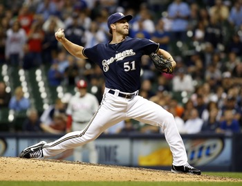 MILWAUKEE, WI - AUGUST 16:  Jim Henderson #51 of the Milwaukee Brewers pitches for the save during game action against the Philadelphia Phillies on August 16, 2012 in Milwaukee, Wisconsin. (Photo by Mark Hirsch/Getty Images)