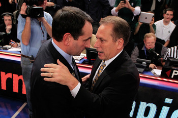 Coach K embracing Tom Izzo after his record-setting 903rd victory.