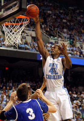 GREENSBORO, NC - MARCH 18:  Harrison Barnes #40 of the North Carolina Tar Heels goes up for a shot over Doug McDermott #3 of the Creighton Bluejays in the second half during the third round of the 2012 NCAA Men's Basketball Tournament at Greensboro Colise