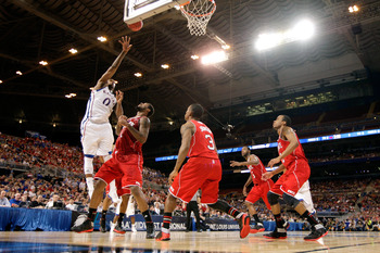 ST. LOUIS, MO - MARCH 23:  Thomas Robinson #0 of the Kansas Jayhawks attempts a shot against Richard Howell #1 of the North Carolina State Wolfpack during the 2012 NCAA Men's Basketball Midwest Regional Semifinal at Edward Jones Dome on March 23, 2012 in