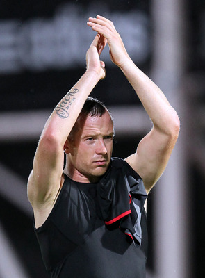 EDINBURGH, SCOTLAND - AUGUST 23:  Charlie Adam of Liverpool applauds the fans during the Hearts v Liverpool UEFA Europa League play-off round match at Tynecastle Stadium, Edinburgh on August 23, 2012 in Edinburgh, Scotland. (Photo by Ian MacNicol/Getty Im