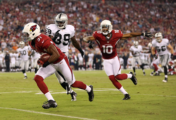Justin Bethel (left) returns a blocked punt for a touchdown against Oakland.