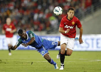 DURBAN, SOUTH AFRICA - JULY 18: Belux Kasonga of Amazulu and Javier Hernandez of Manchester United battle for the ball  during the MTN Football Invitational match between Amazulu and Manchester United, at Moses Mabhida Stadium on July 18, 2012 in Durban,