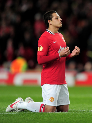 MANCHESTER, ENGLAND - MARCH 08:  Javier Hernandez of Manchester United says a prayer prior to the UEFA Europa League Round of 16 first leg match between Manchester United and Athletic Bilbao at Old Trafford on March 8, 2012 in Manchester, England. (Photo