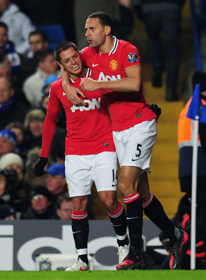 LONDON, ENGLAND - FEBRUARY 05:  Javier Hernandez of Manchester United (R) celebrates with team mate Rio Ferdinand as he scores their third goal with a header during the Barclays Premier League match between Chelsea and Manchester United at Stamford Bridge