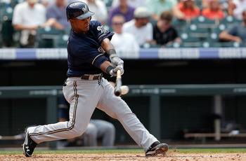 DENVER, CO - AUGUST 15:  Jean Segura #9 of the Milwaukee Brewers takes an at bat against the Colorado Rockies at Coors Field on August 15, 2012 in Denver, Colorado. The Rockies defeated the Brewers 7-6.  (Photo by Doug Pensinger/Getty Images)