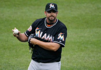 NEW YORK, NY - APRIL 26: Heath Bell #21 of the Miami Marlins looks on during the game against the New York Mets at Citi Field on April 26, 2012 in the Flushing neighborhood of the Queens borough of New York City. Mets defeated the Marlins 3-2.  (Photo by