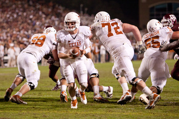 COLLEGE STATION, TX - NOVEMBER 24:  Case McCoy #6 of the Texas Longhorns looks to hand off against the Texas A&M Aggies in the second half of a game at Kyle Field on November 24, 2011 in College Station, Texas. (Photo by Darren Carroll/Getty Images)