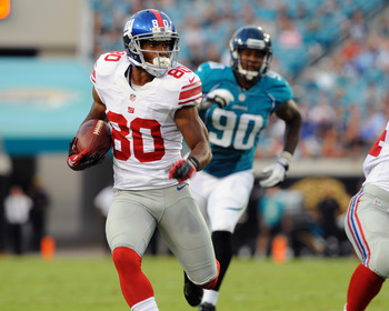 JACKSONVILLE, FL - AUGUST 10:  Wide receiver Victor Cruz #80 of  the New York Giants rushes upfield with a pass against the Jacksonville Jaguars in a pre-season football game August 10, 2011 at EverBank Field in Jacksonville, Florida. (Photo by Al Messers