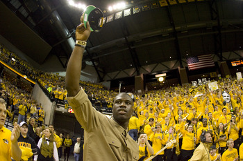 Dorial Green-Beckham salutes the crowd at a Missouri basketball game in Columbia.