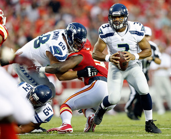 KANSAS CITY, MO - AUGUST 24:  Quarterback  Russell Wilson #3 of the Seattle Seahawks scrambles during the NFL preseason game against the Kansas City Chiefs at Arrowhead Stadium on August 24, 2012 in Kansas City, Missouri.  (Photo by Jamie Squire/Getty Ima