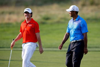 The future (McIlroy, left) and past (Woods)?