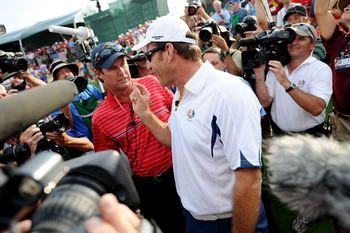 One of the many semi-tense moments between Paul Azinger (left) and Nick Faldo