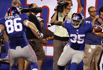 Aug 24, 2012; East Rutherford, NJ, USA; New York Giants running back Andre Brown (35) celebrates with tight end Bear Pascoe (86) after scoring a touchdown during the game against the Chicago Bears at MetLife Stadium.  Mandatory Credit: William Perlman/THE