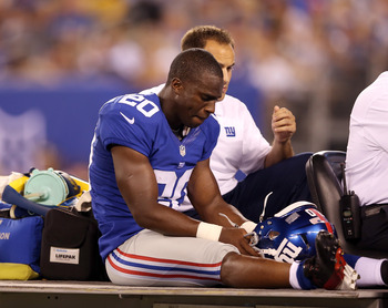 EAST RUTHERFORD, NJ - AUGUST 24:   Prince Amukamara #20 of the New York Giants is carted off the field in the first half against the Chicago Bears during a preseason game on August 24, 2012 at MetLife Stadium in East Rutherford, New Jersey.  (Photo by Els