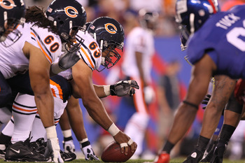 The Bears' offensive line prepares to battle the Giants' defensive line.