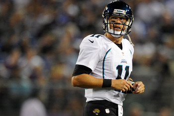 BALTIMORE, MD - AUGUST 23: Quarterback Blaine Gabbert #11 of the Jacksonville Jaguars walks off the field against the Baltimore Ravens during the preseason game at M&amp;T Bank Stadium on August 23, 2012 in Baltimore, Maryland. The Baltimore Ravens won 48-17.