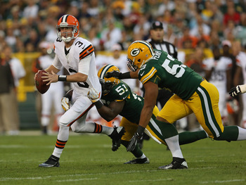 GREEN BAY, WI - AUGUST 16: Brandon Weeden #3 of the Cleveland Browns tries to pass as he is chased by D.J. Smith #51 and Nick Perry #53 (R) of the Green Bay Packers during a preseason game at Lambeau Field on August 16, 2012 in Green Bay, Wisconsin. The B