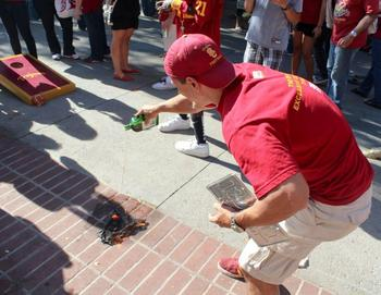USC Syco at Stanford tailgate burning the towels they gave out at the Notre Dame game in South Bend