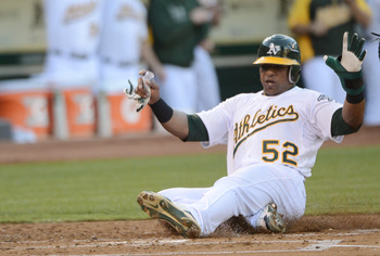 Yoenis Cespedes slides into home safely
