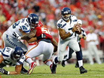 KANSAS CITY, MO - AUGUST 24:  Quarterback  Russell Wilson #3 of the Seattle Seahawks in action during the NFL preseason game against the Kansas City Chiefs at Arrowhead Stadium on August 24, 2012 in Kansas City, Missouri.  (Photo by Jamie Squire/Getty Ima