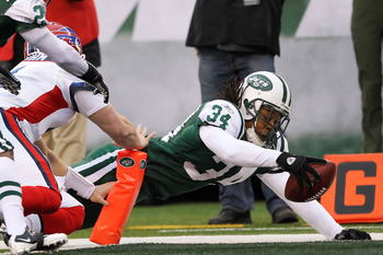 EAST RUTHERFORD, NJ - JANUARY 02:  Marquice Cole #34 of the New York Jets scores a touchdown on an interception return against Brian Brohm #4 of the Buffalo Bills at New Meadowlands Stadium on January 2, 2011 in East Rutherford, New Jersey.  (Photo by Al 