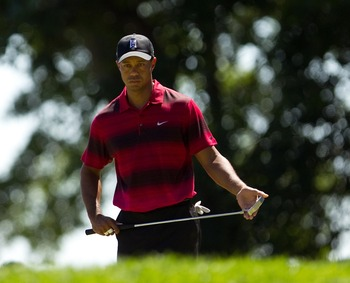 Tiger Woods staring down a putt