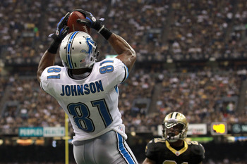 NEW ORLEANS, LA - JANUARY 07:  Calvin Johnson #81 of the Detroit Lions catches a pass for a touchdown in the second quarter against the New Orleans Saints during their 2012 NFC Wild Card Playoff game at Mercedes-Benz Superdome on January 7, 2012 in New Or