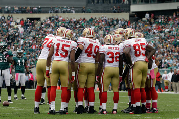 PHILADELPHIA, PA - OCTOBER 02: Members of the San Francisco 49ers offense gather in the huddle against the Philadelphia Eagles at Lincoln Financial Field on October 2, 2011 in Philadelphia, Pennsylvania. The 49ers won 24-23.   (Photo by Rob Carr/Getty Ima