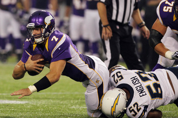 Aug 24, 2012; Minneapolis, MN, USA; Minnesota Vikings quarterback Christian Ponder (7) is sacked by San Diego Chargers linebacker Larry English (52) during the second quarter at the Metrodome. Mandatory Credit: Brace Hemmelgarn-US PRESSWIRE