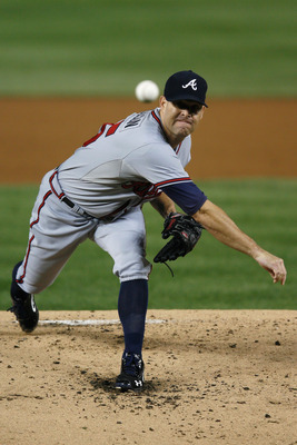 WASHINGTON, DC - AUGUST 20: Starting pitcher Tim Hudson #15 of the Atlanta Braves throws to a Washington Nationals batter during the first inning at Nationals Park on August 20, 2012 in Washington, DC.  (Photo by Rob Carr/Getty Images)