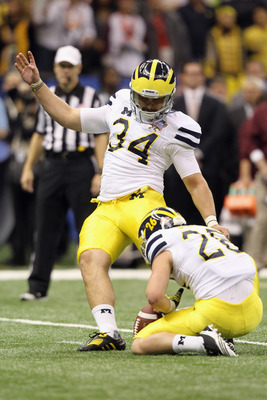 Brendan Gibbons kicks the ball for Michigan.
